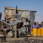 A girl pumps water from a borehole provided by UNICEF in Old Maiduguri, Borno State, Nigeria, Thursday 2 March 2017.