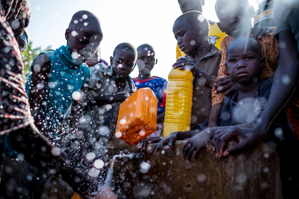 Internally Displaced People fill containers with water at a tap inside the Dalori camp in Maiduguri, Borno State, Nigeria, Friday 3 March 2017.  The prolonged humanitarian crisis in the wake of the Boko Haram insurgency has had a devastating impact on food security and nutrition in northeast Nigeria, leading to famine-like conditions in some areas, according to a World Food Programme (WFP) situation report from late February 2017. The United Nations Office for the Coordination of Humanitarian Affairs (OCHA) projects that by June 2017 some 5.1 million people in Nigeria will be food insecure at crisis and emergency levels. As of 15 March 2017, over the past 12 months, UNICEF and partners have provided safe water to nearly 666,000 people and treated nearly 170,000 children suffering from severe acute malnutrition in the three conflict-affected northeast Nigerian states of Borno, Yobe and Adamawa. As part of cholera preparedness, UNICEF and other WASH Sector partners are building the capacity of government and NGOs on cholera response and developing contingency plans with other stakeholders before the rainy season starting mid-April. Prepositioning of supplies for cholera response and mapping cholera hotspots are part of the preventive measures that are being planned.